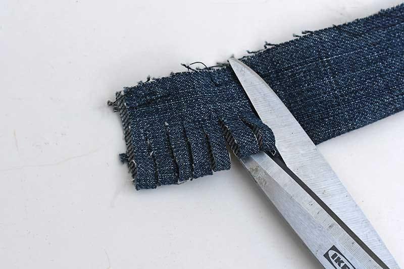 Cutting the folded denim strip