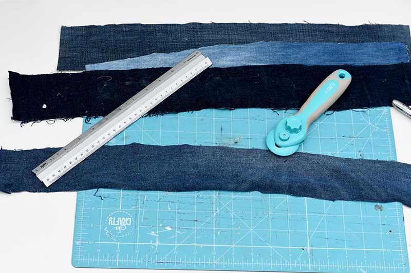 Cutting strips of denim