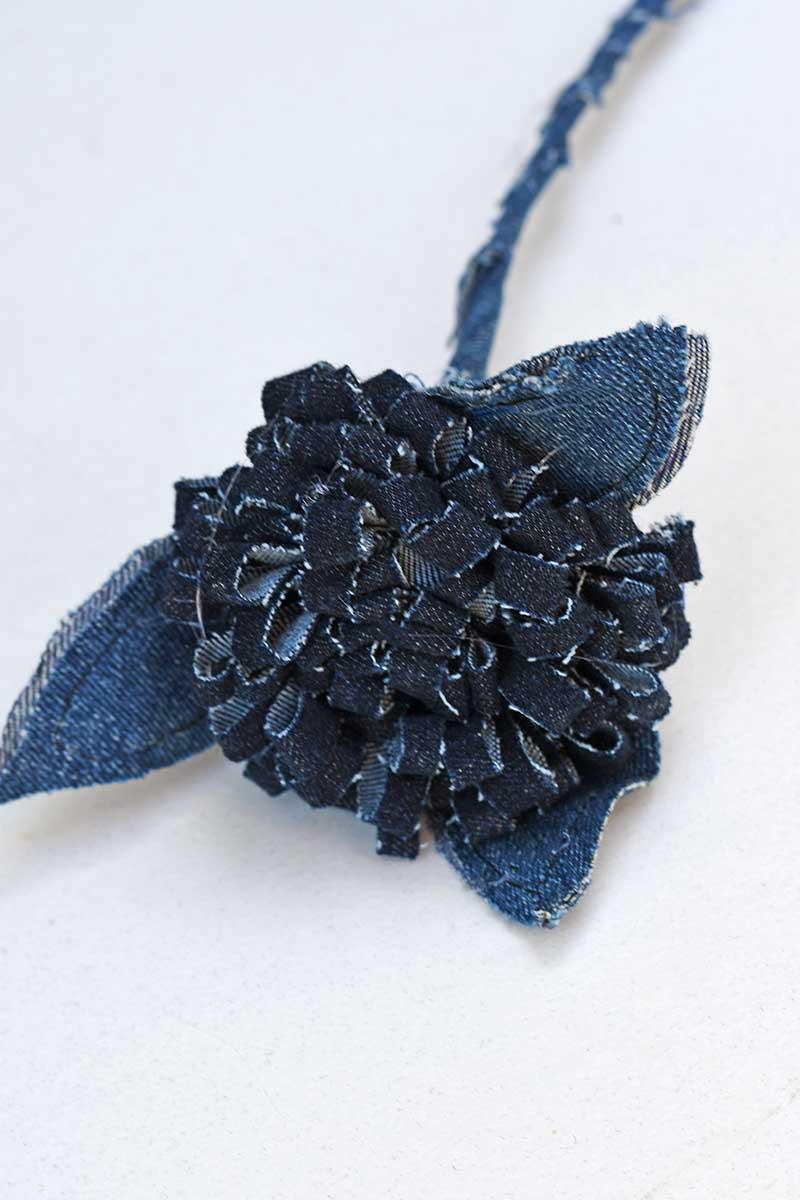 Upcycled pom pom jeans flower