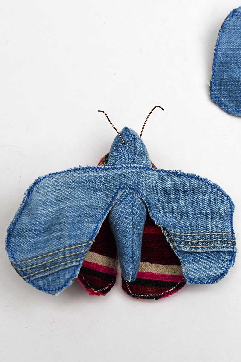 Faux denim scrap fabric moth taxidermy