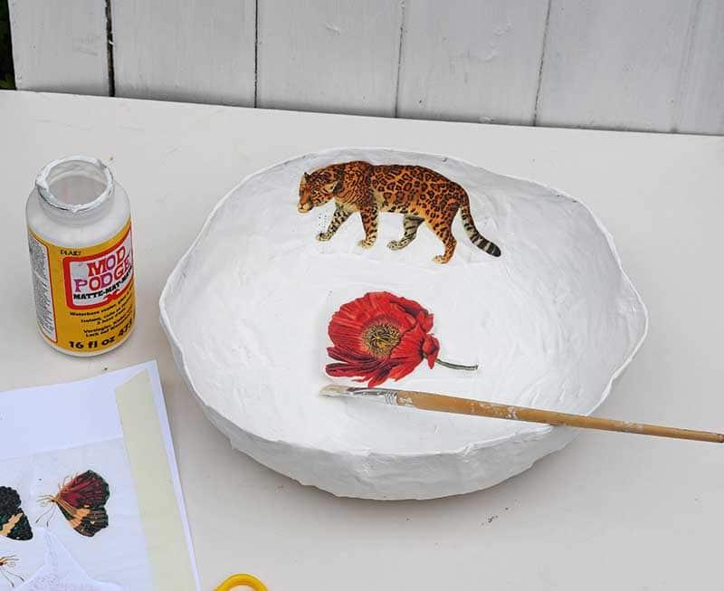 Decoupage a paper mache bowl