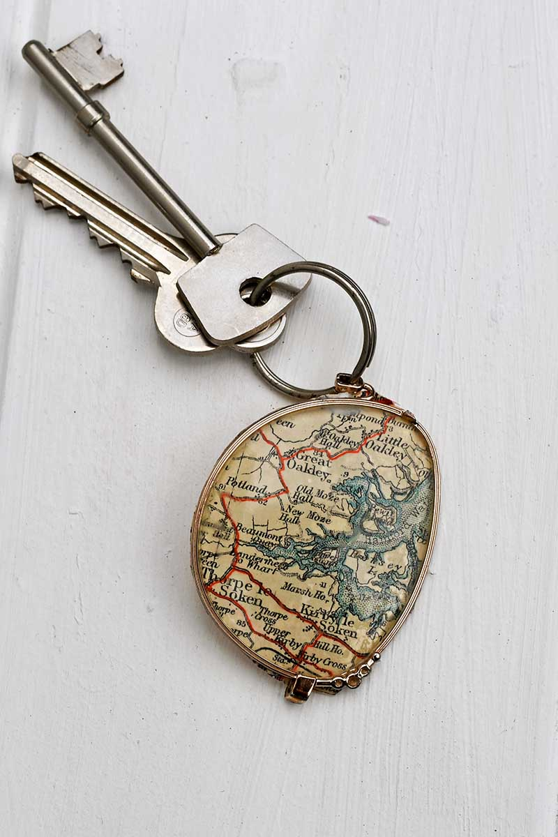 Upcycled road map keychain