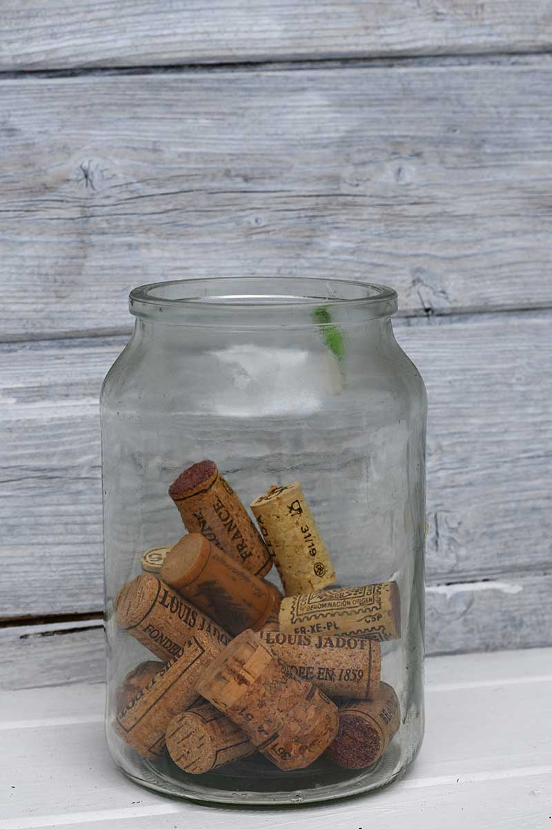 A glass jar of old wine corks