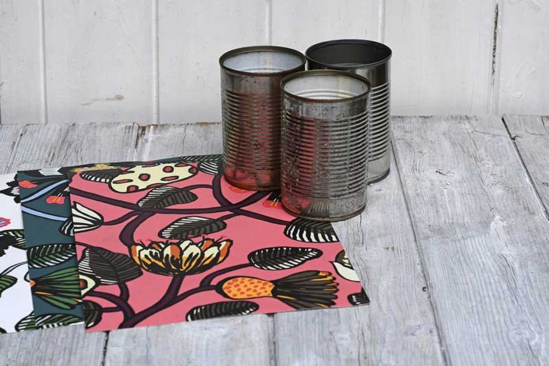 Wallpaper samples and tin cans