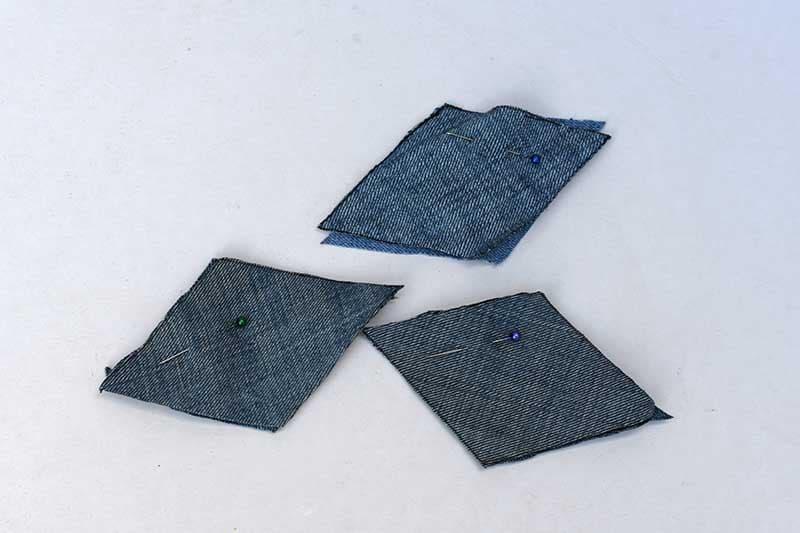 Scrap denim diamonds pinned right sides