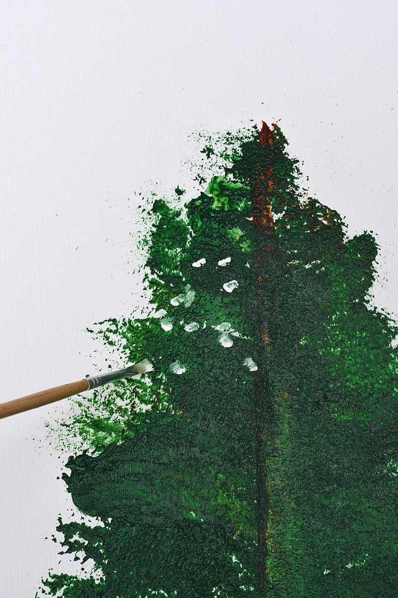 Painting snow onto the Christmas tree