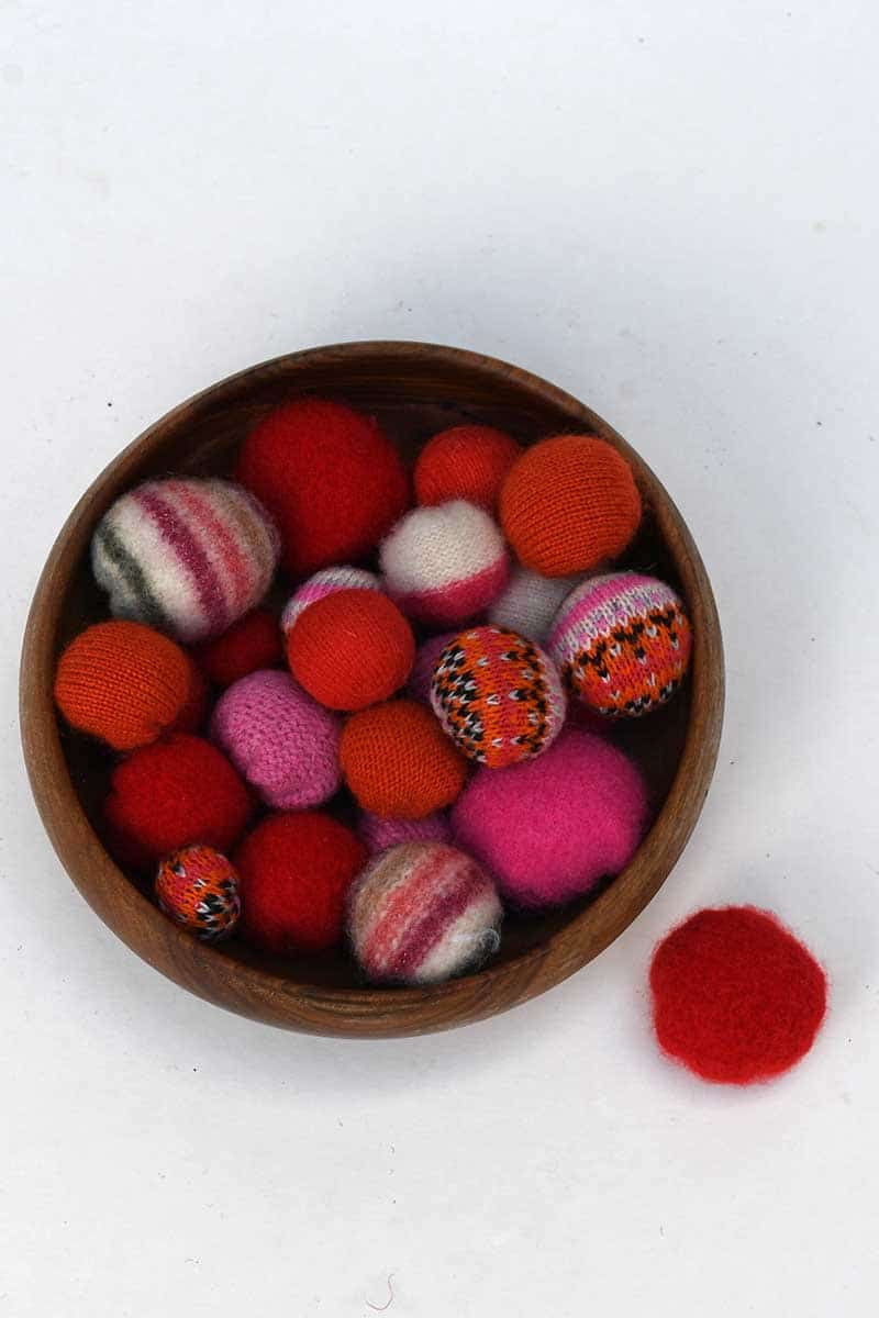 bowl of repurposed sweater balls