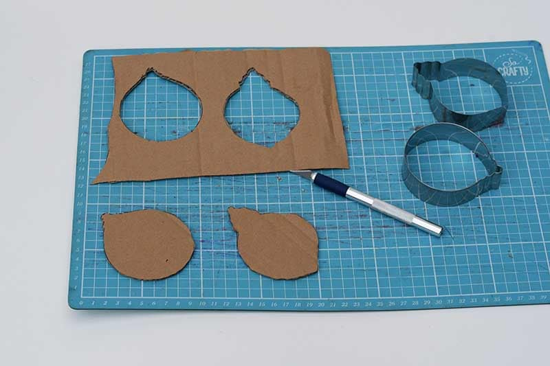 cutting out the cardboard shapes