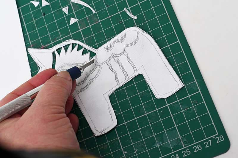 Cutting out Dala Horse stencil