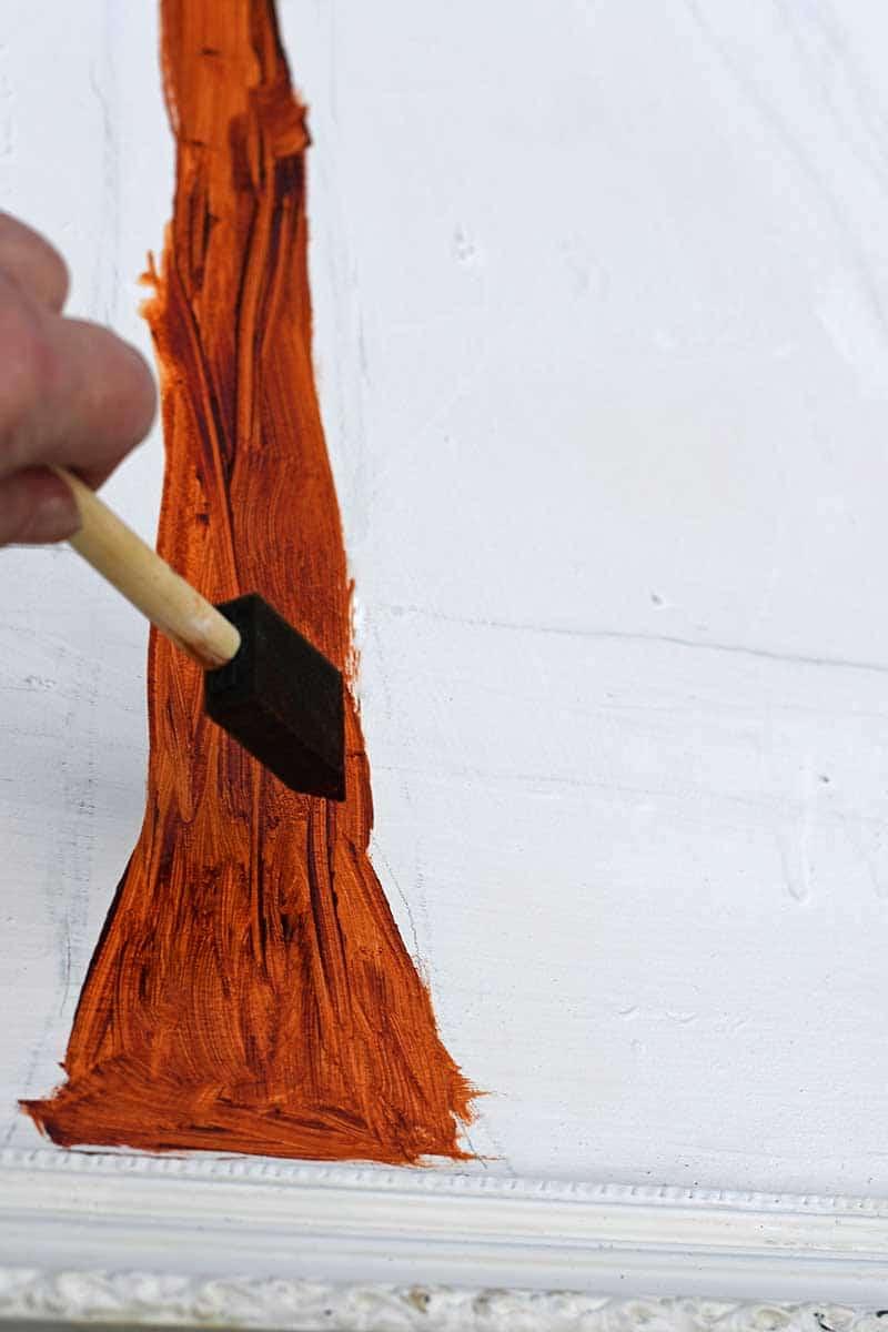 Painting Christmas tree trunk brown