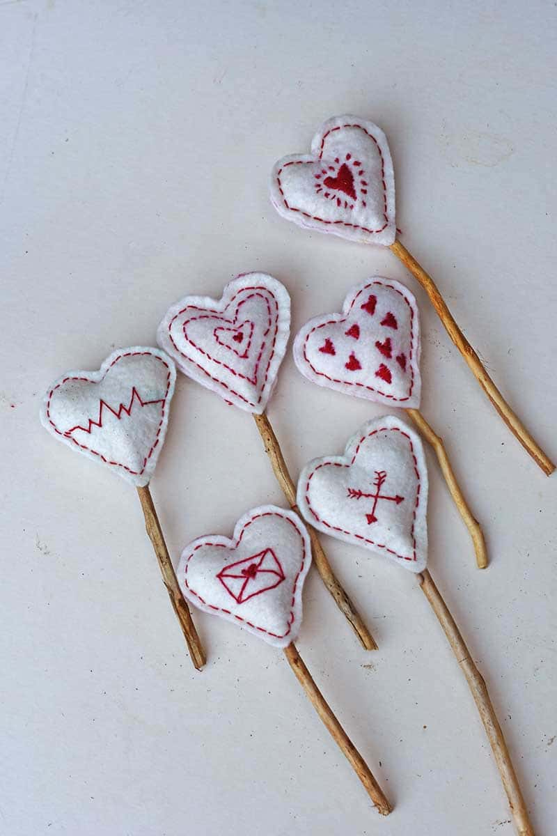 Embroidered Scandi hearts for a mantle decoration