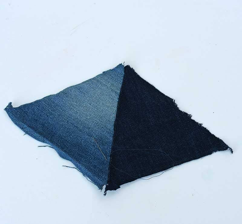 Two triangles stitched together
