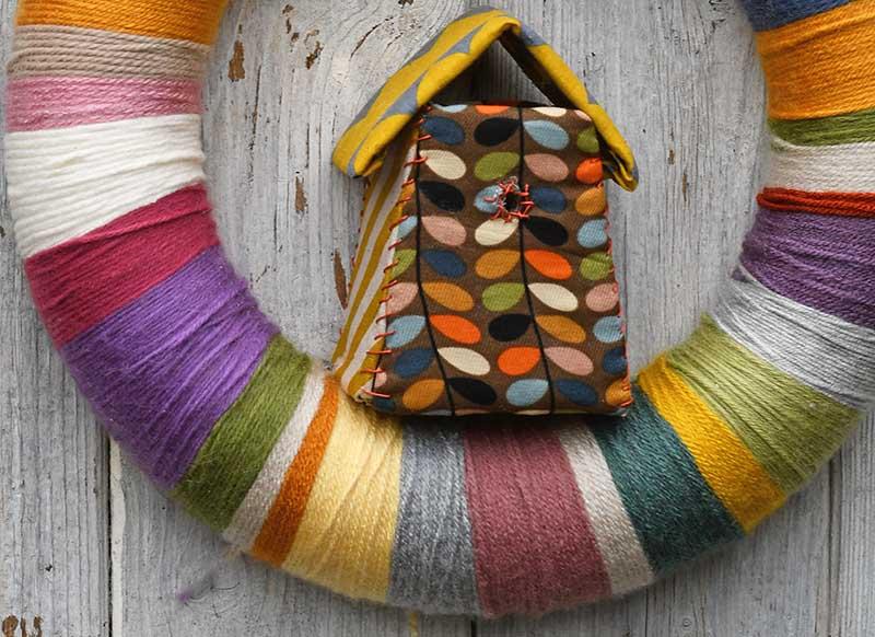 Adding bird house to DIY yarn wreath
