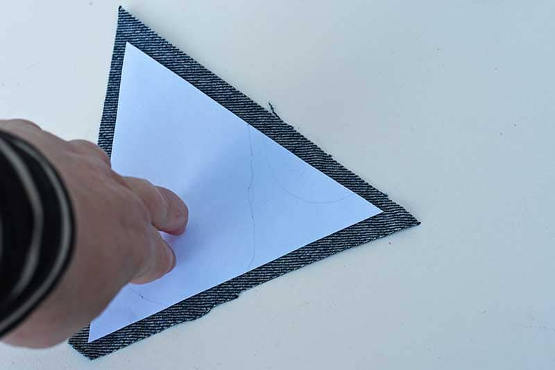 sticking paper triangle to denim