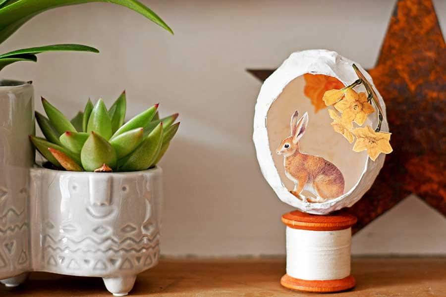 Mantel paper mache egg and rabbit decoration