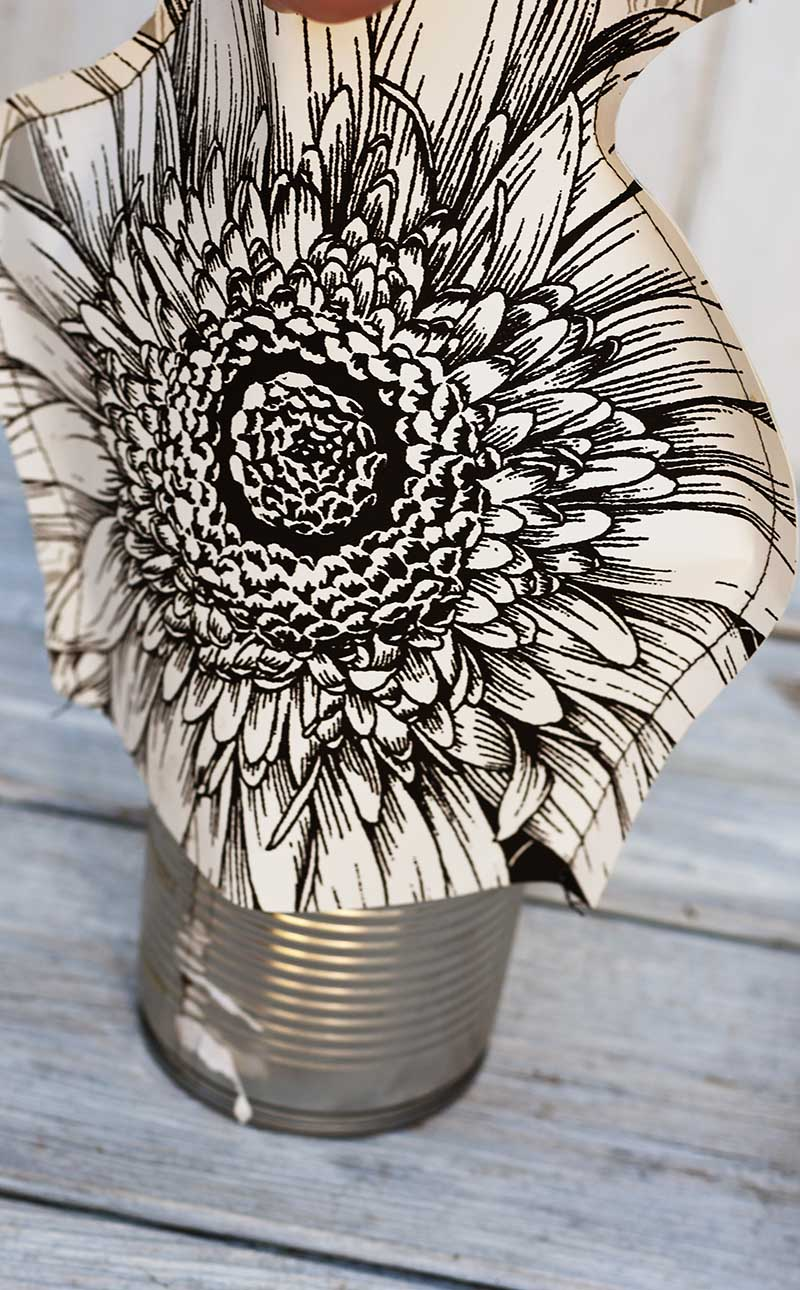 placing paper vase over a tin can