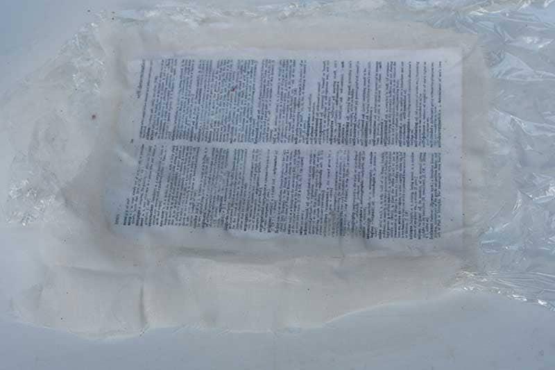 Laying muslin onto paper