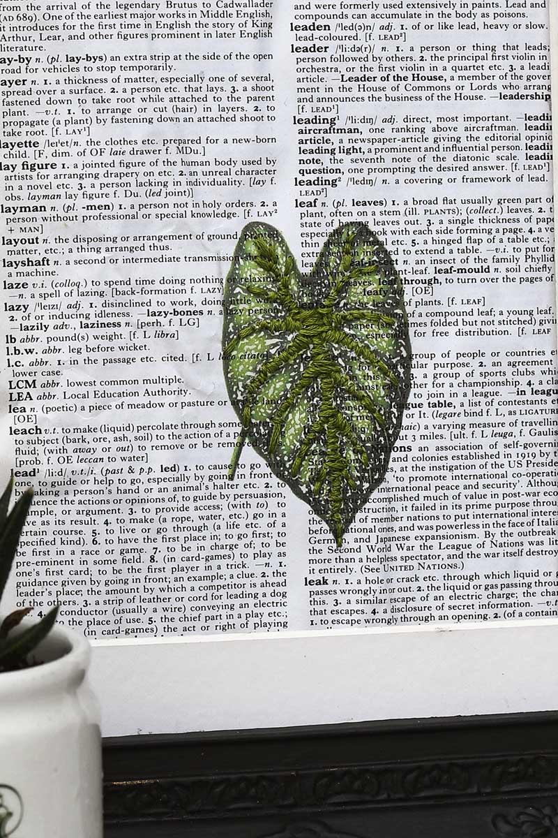 leaf embroidered on paper