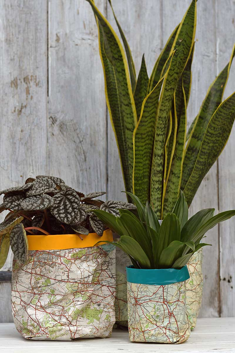 Upcycled map plant pot covers