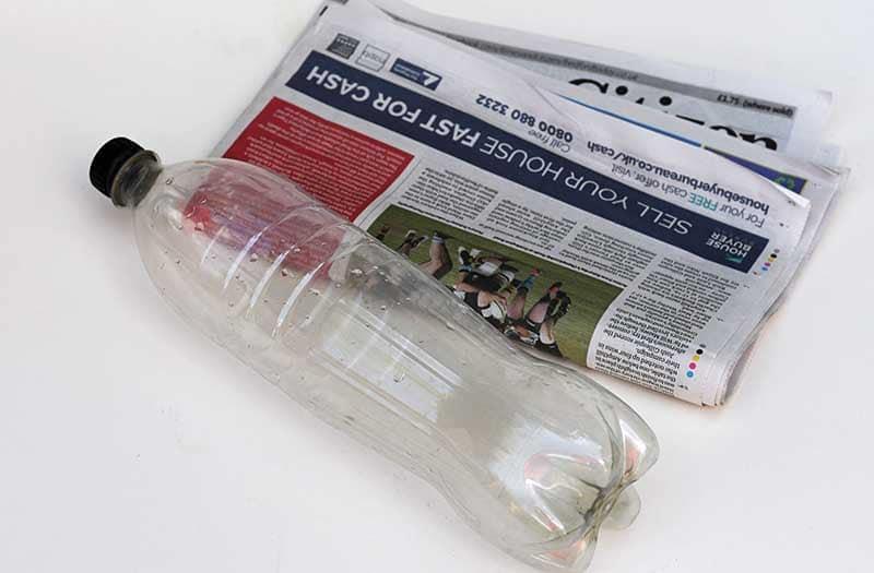 coke bottle and newspaper