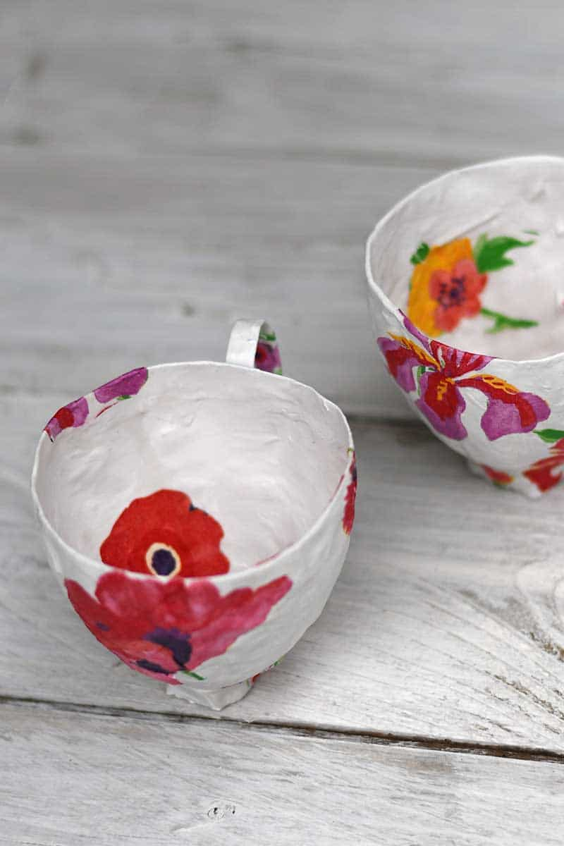Inside paper mache teacups