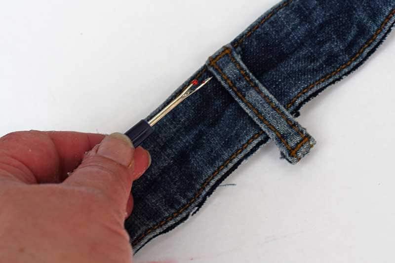 unpicking belt loop from a waistband
