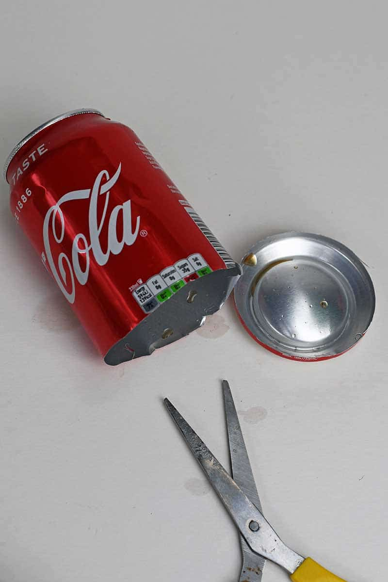 Cutting the base off a soda can