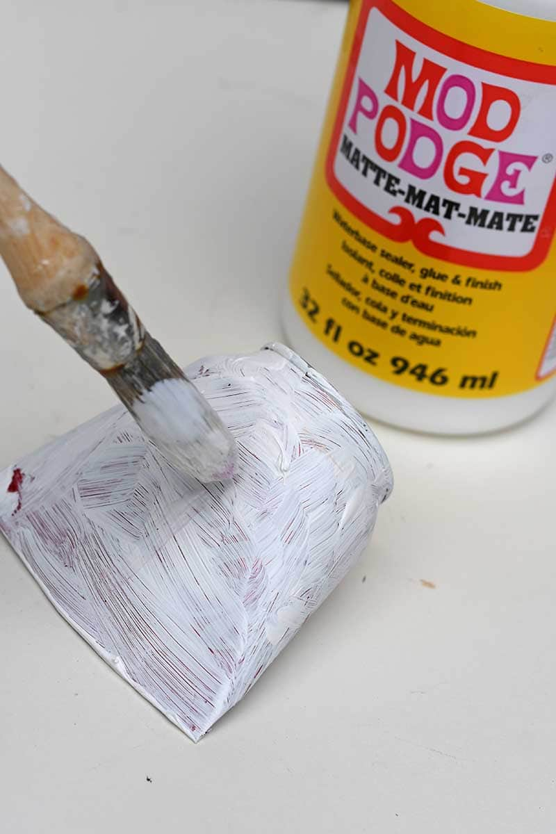 Pasting can in Mod Podge