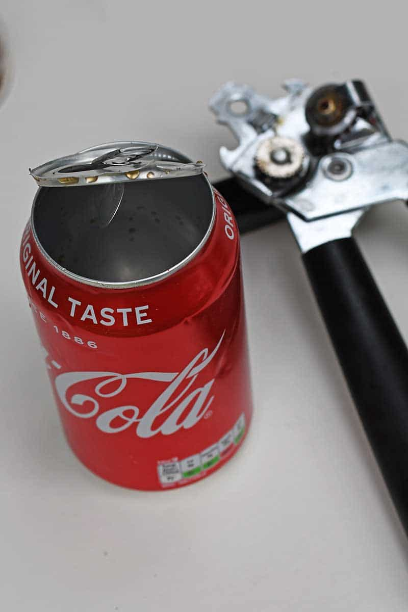 Taking the top off a coke can