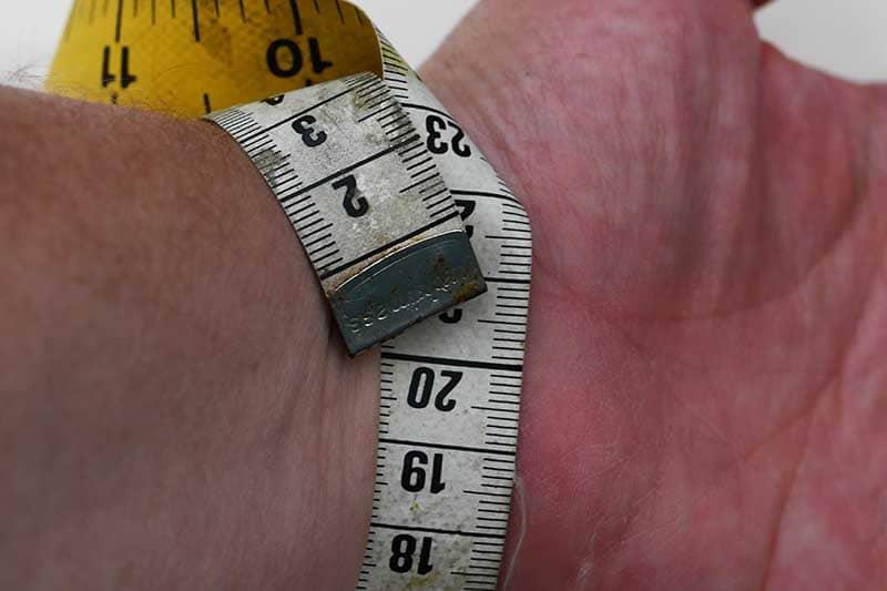 Measuring wrist for DIY denim bracelet